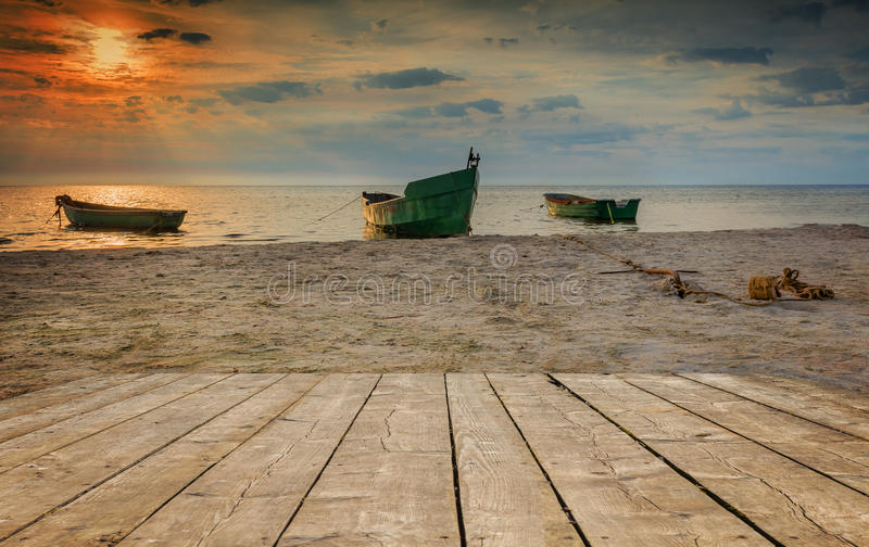 Coastal landscape, Baltic Sea. Anchored boat on sandy beach of the Baltic Sea. The image symbolizing traditional fisheries in the Riga gulf of Latvian Republic royalty free stock image