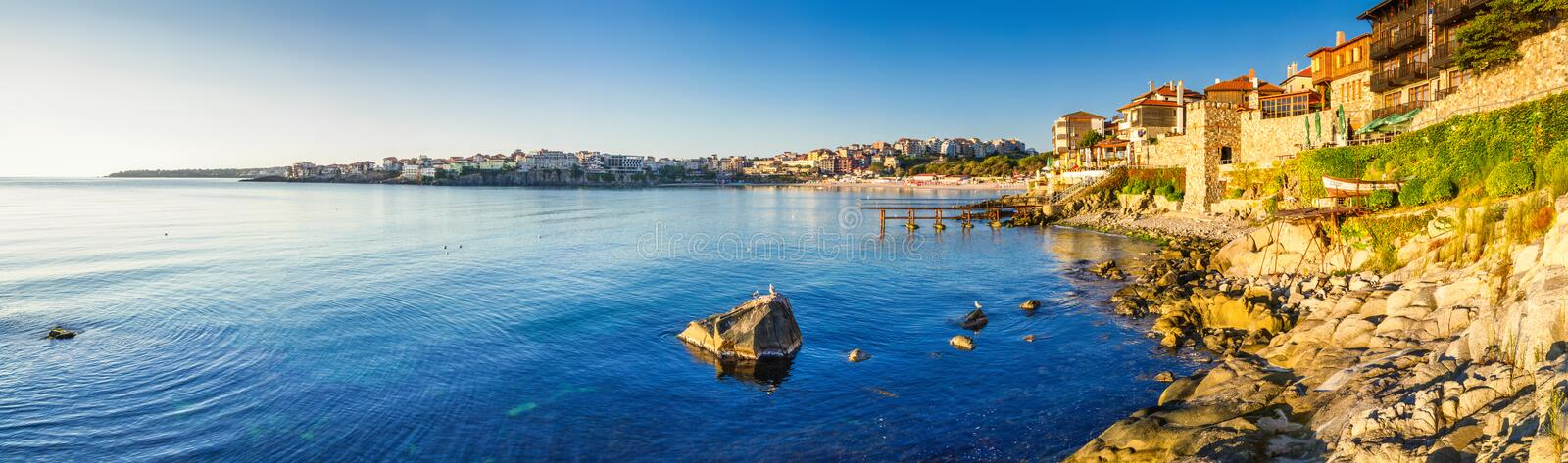 Coastal landscape banner, panorama - embankment with fortress wall in the city of Sozopol. On the Black Sea coast in Bulgaria stock photo