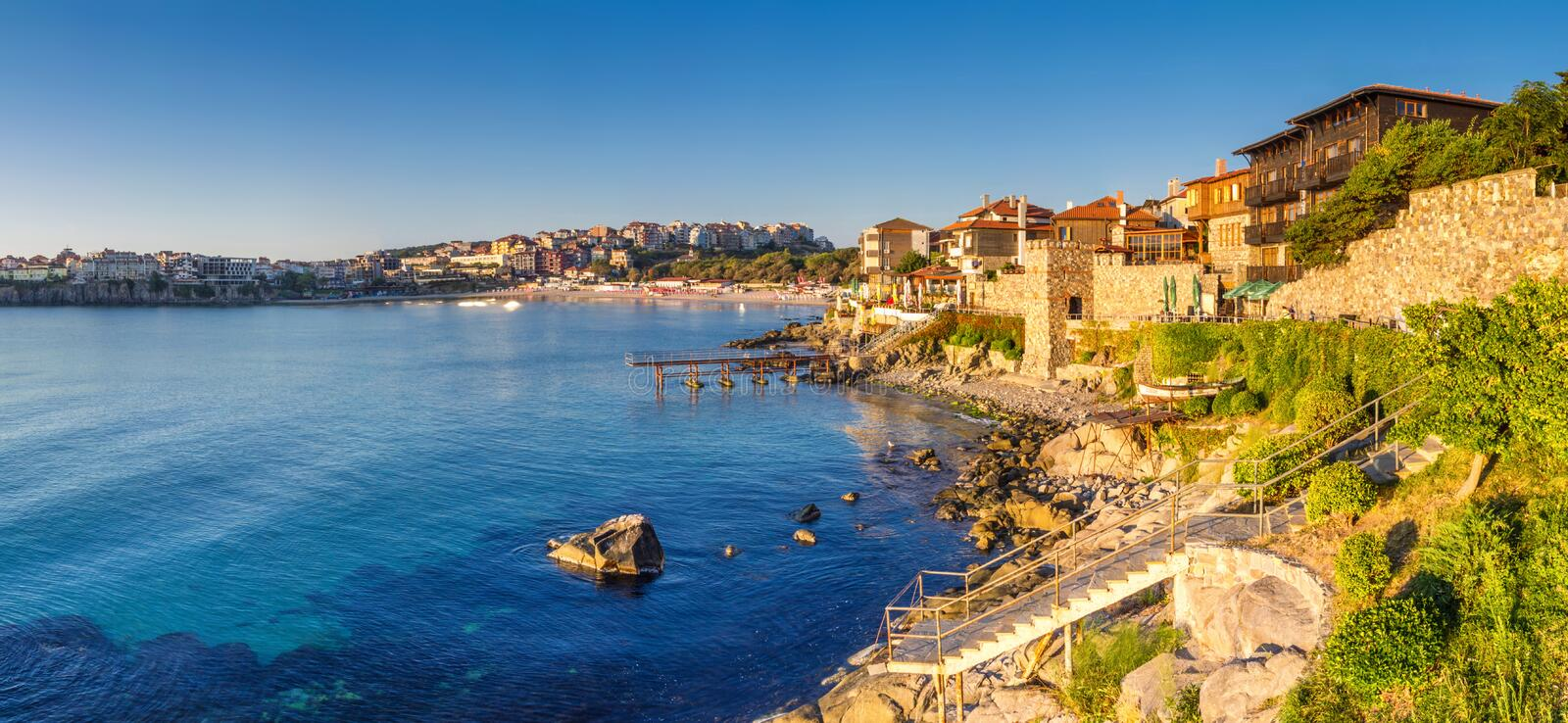 Coastal landscape banner, panorama - embankment with fortress wall in the city of Sozopol royalty free stock photography