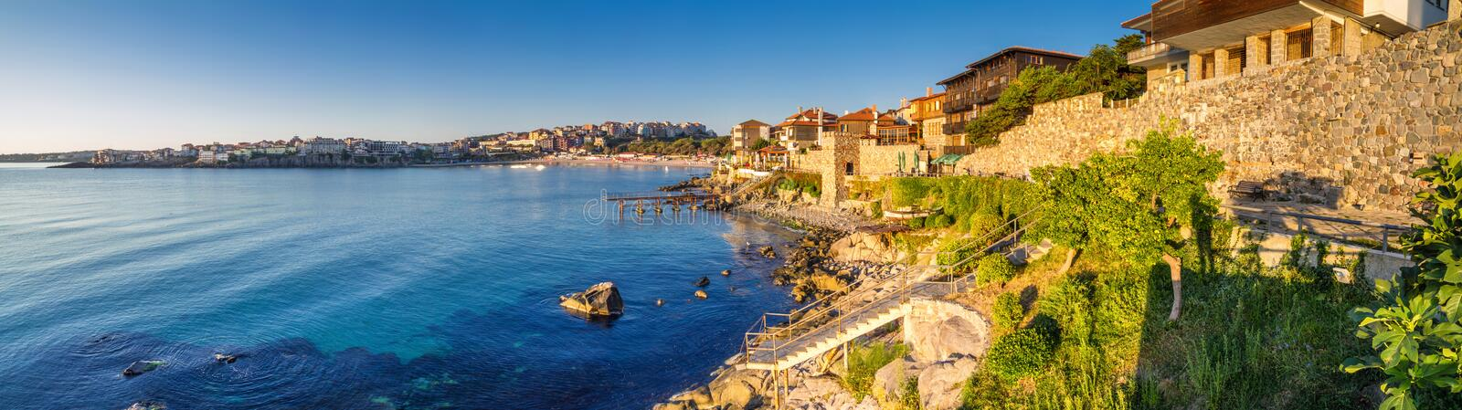 Coastal landscape banner, panorama - embankment with fortress wall in the city of Sozopol. On the Black Sea coast in Bulgaria royalty free stock images