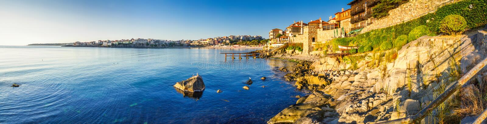 Coastal landscape banner, panorama - embankment with fortress wall in the city of Sozopol. On the Black Sea coast in Bulgaria stock images