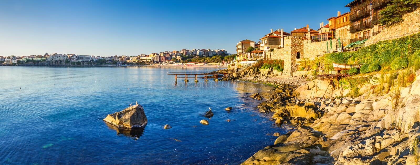 Coastal landscape banner, panorama - embankment with fortress wall in the city of Sozopol. On the Black Sea coast in Bulgaria royalty free stock photo
