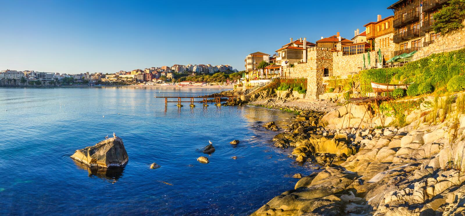Coastal landscape banner, panorama - embankment with fortress wall in the city of Sozopol. On the Black Sea coast in Bulgaria royalty free stock photos