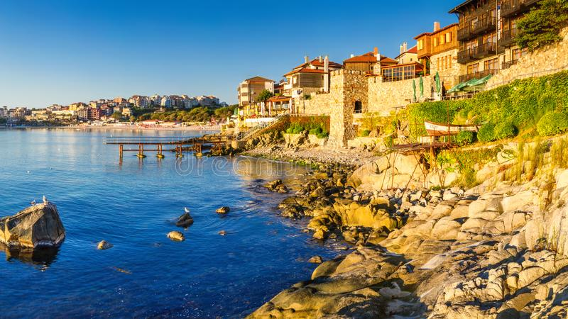 Coastal landscape banner, panorama - embankment with fortress wall in the city of Sozopol. On the Black Sea coast in Bulgaria royalty free stock photography