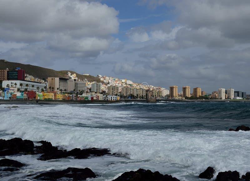 Coastal landscape, Las Palmas, Gran Canaria. Coastal landscape with strong waves, city and cloudy sky, Las Palmas de Gran Canaria stock photos
