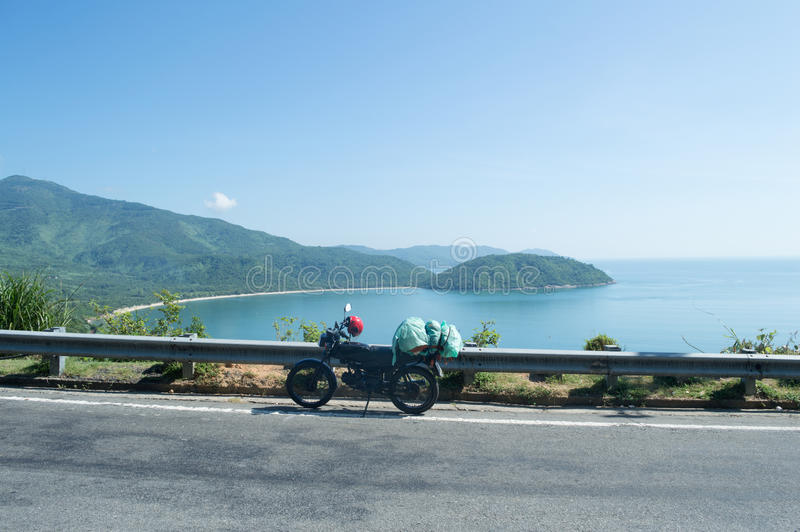 Coastal Landscape with Motorcycle and Road near Hoi An, Vietnam stock photo
