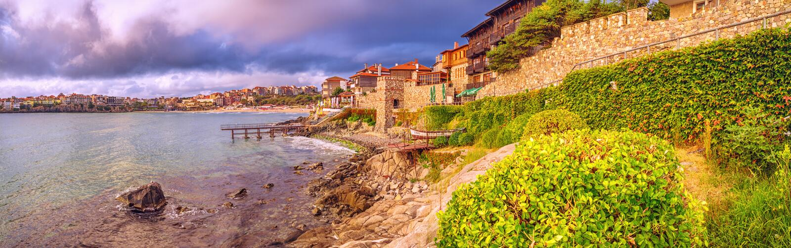 Coastal landscape, panorama, banner - embankment with fortress wall in the city of Sozopol. On the Black Sea coast in Bulgaria stock photo