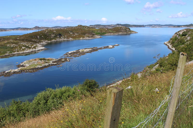 Coastal landscape in West Norway, near the Boknafjord. On the road in Norway, from Bergen to Stavanger: A coastal landscape with many small islands, reefs and royalty free stock photos