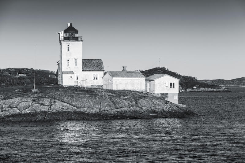 Coastal lighthouse located in Smola, Norway. Tyrhaug Lighthouse. Coastal lighthouse located in Smola Municipality, Norway. Black and white photo stock photo