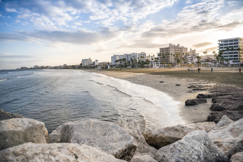 Coastal line in Larnaca at sunset, Cyprus. Mediterranean Sea and coastal line in Larnaca at sunset, Cyprus royalty free stock photography
