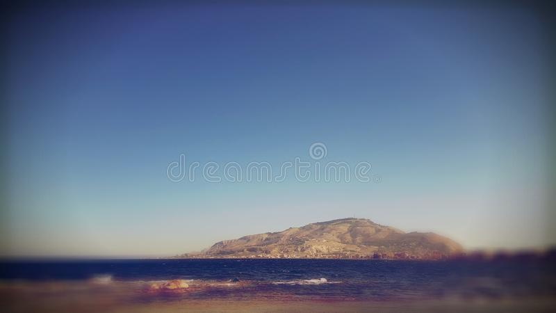 Coastal mountains. Coastal mountain range against blue skies on sunny day stock images