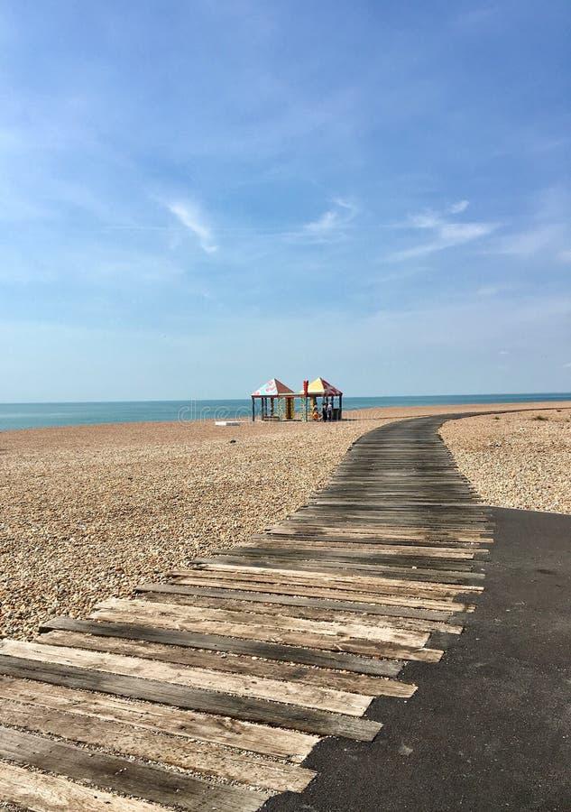 Coastal path and colourful pastel beach huts stock photo