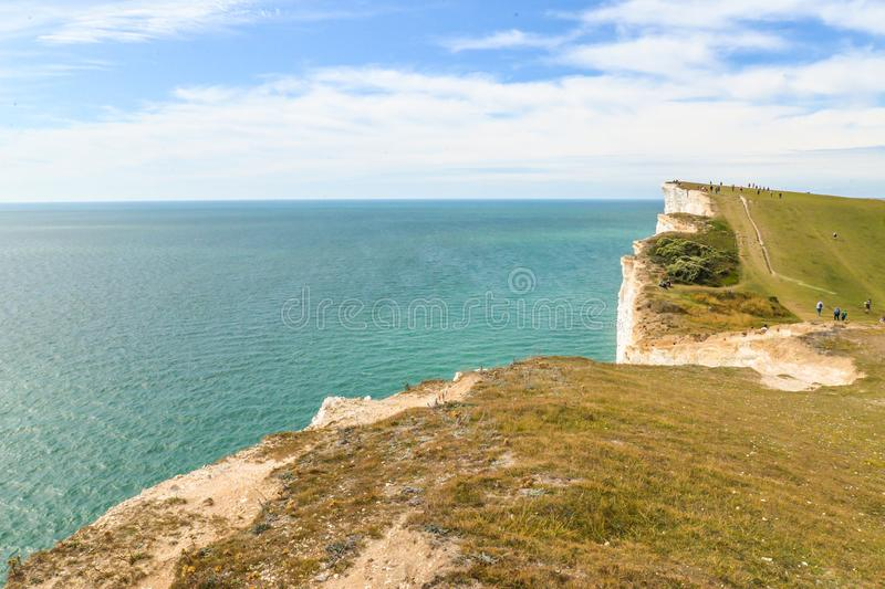 Summertime coastal path along cliffs. The coastal path from Eastbourne to East Dean, across the highest chalk cliffs in the United Kingdom royalty free stock image