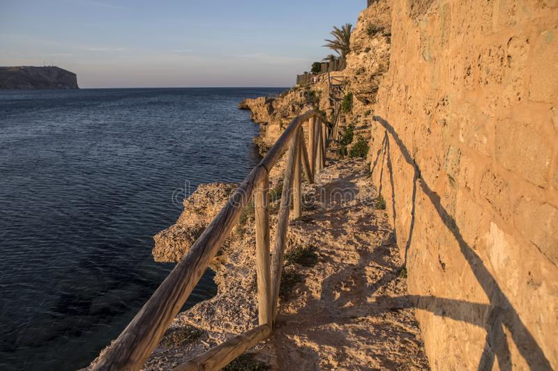 Coastal Path in Javea in Spain. A view of the rocky coastal path in Javea, Spain stock image