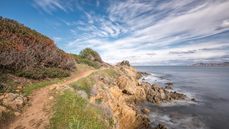 Coastal path at Lozari beach in Corsica stock image