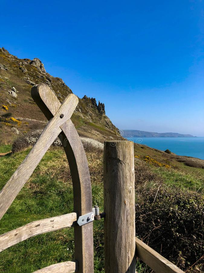 The coastal path near to Salcombe in Devon. A gate on the South West Coastal Path with the sea in the background cliffs and the English Channel stock image