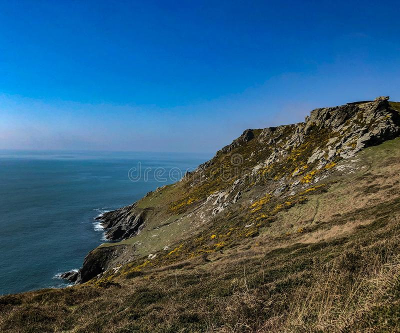 The coastal path near to Salcombe in Devon. A gate on the South West Coastal Path with the sea in the background cliffs and the English Channel royalty free stock image