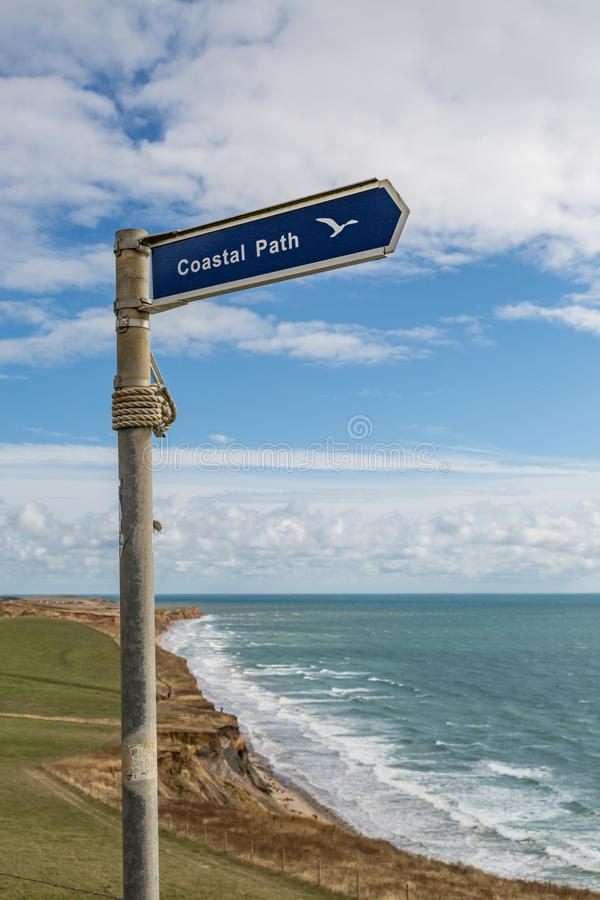 A Coastal Path Signpost. A signpost directing along a coastal path near Compton Bay on the Isle of Wight royalty free stock photo