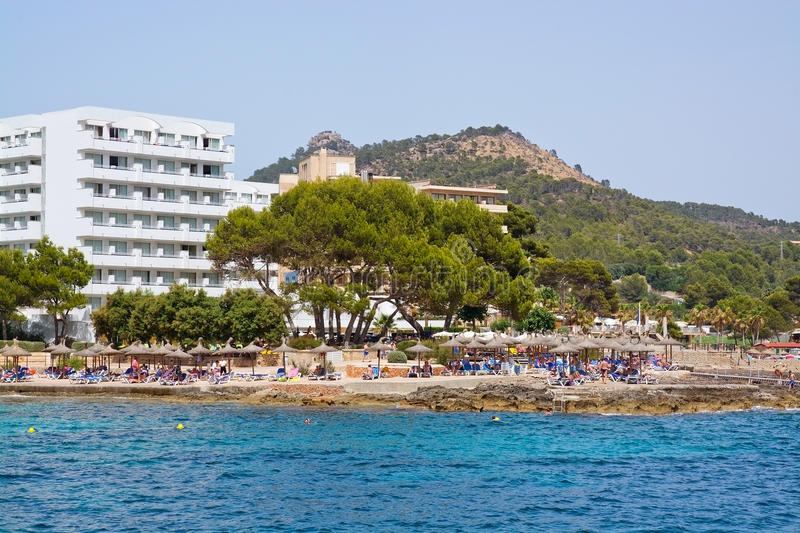 Coastal resort. MALLORCA, BALEARIC ISLANDS, SPAIN - JULY 19, 2014: Coastal resort and white hotel in the southwest part of the island on a sunny summer day on stock photo
