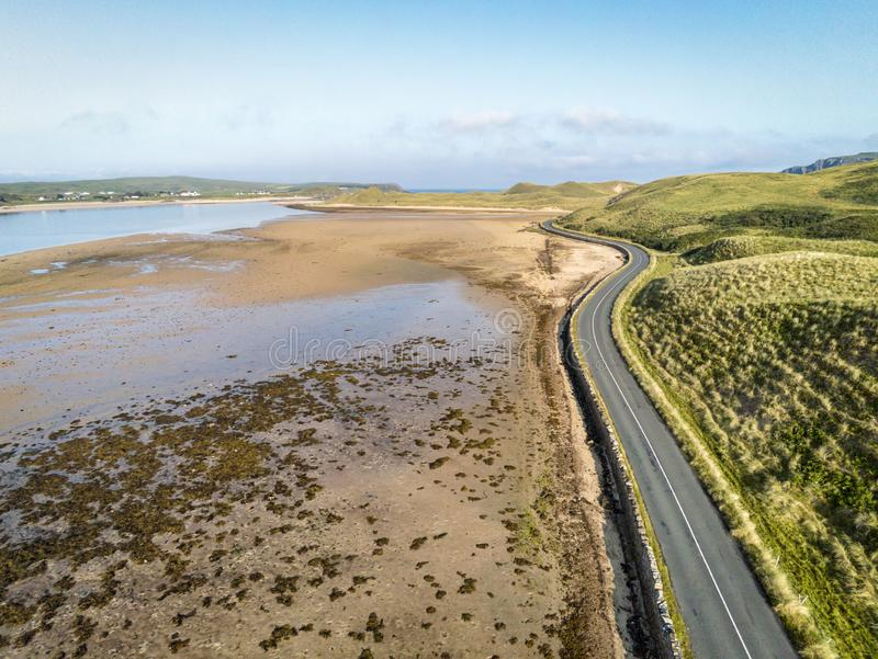 Coastal Road. A coastal road at low tide in county Donegal Ireland royalty free stock images
