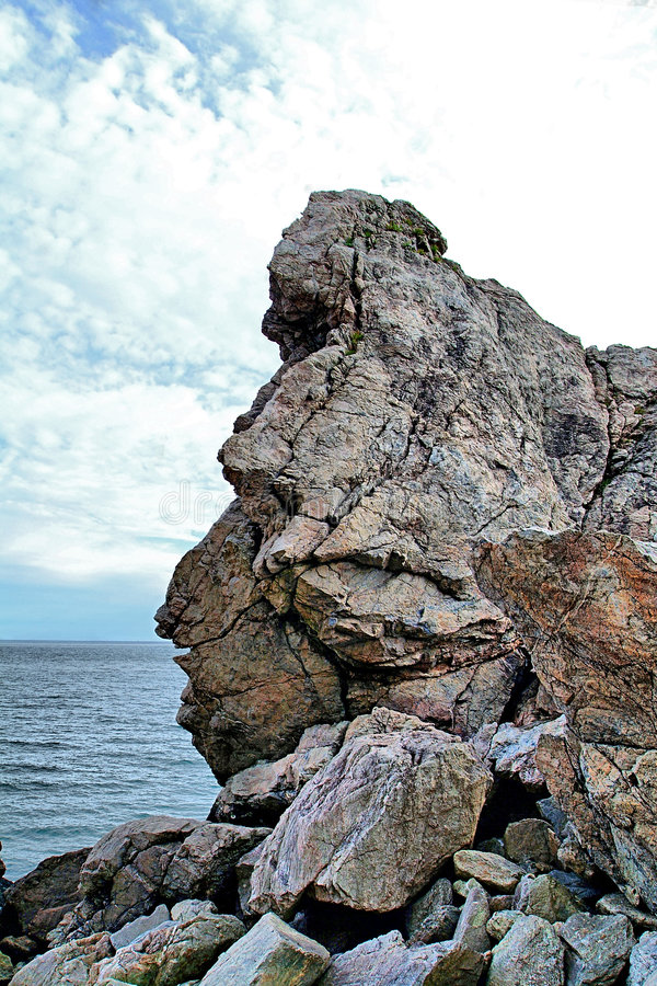 Coastal Rock. S with blue sky, white cloud and blue sea stock images