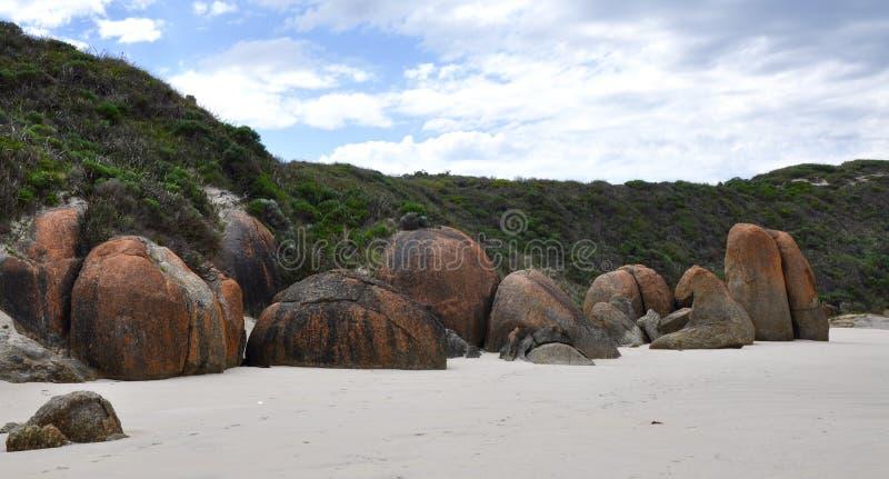 Coastal Rocks Colored with Orange Lichen stock photos