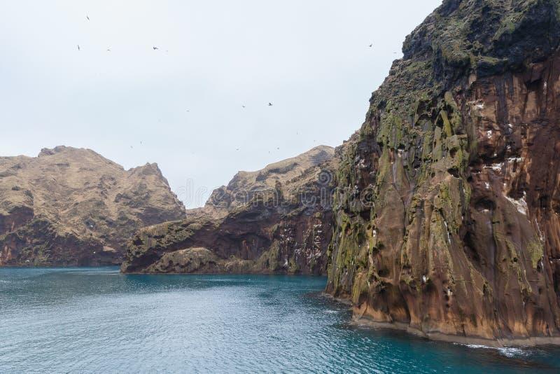 Coastal rocks of Vestmannaeyjar island royalty free stock photos