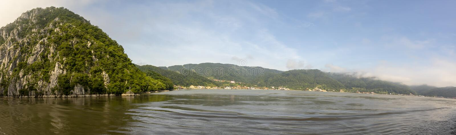 Coastal Romanian town in Iron Gate. Coastal Romanian Town the Iron Gate gorges on the Danube River between Serbia and Romania stock images