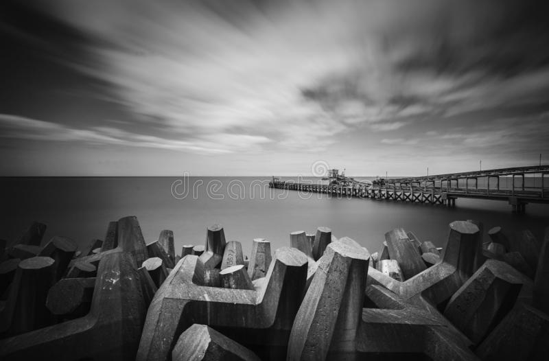 Coastal Sea Defence. Fine Art Long Exposure Monochrome, Coastal Sea Defence Ethereal, off the coast of Colwyn Bay, North Wales, United Kingdom stock images
