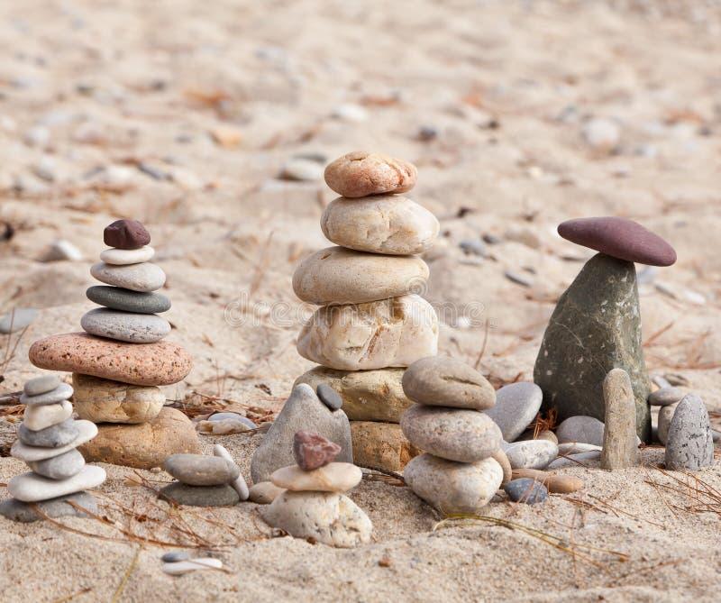 Coastal stones pyramids 3 stock images