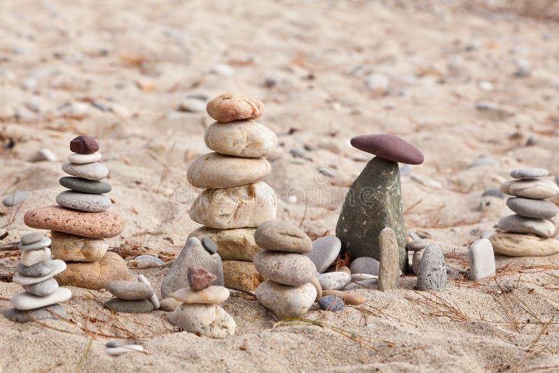 Coastal stones pyramids 4 stock image