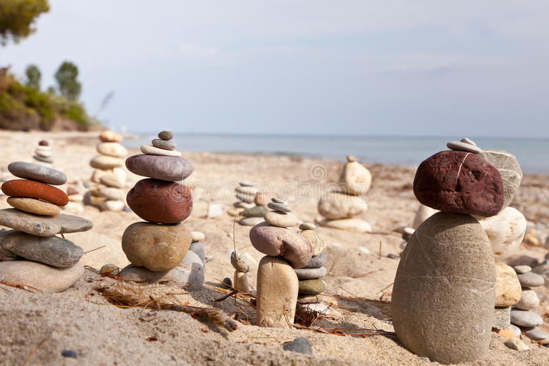 Coastal stones pyramids royalty free stock photos
