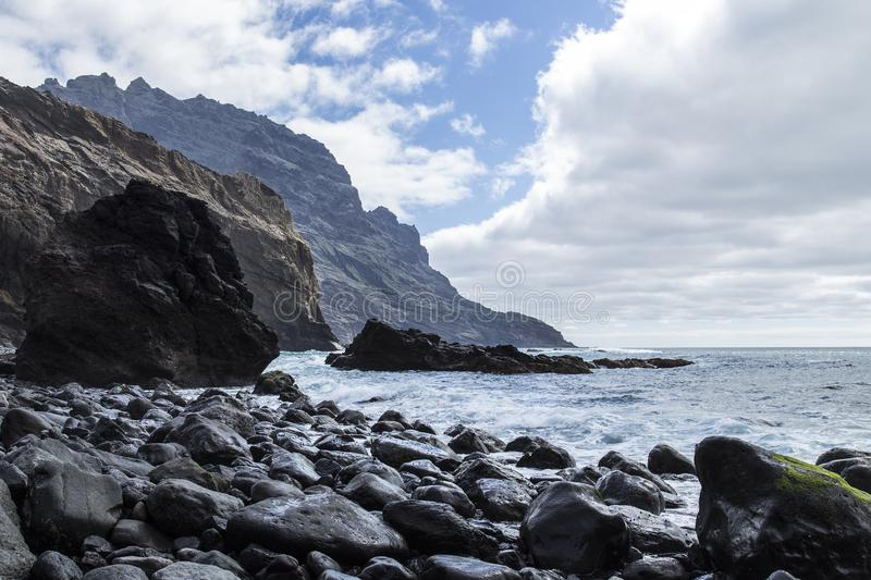 The coastal strip of the volcanic island of La Gomera, rising from the Atlantic Ocean. The coastal strip of La Gomera is rugged and stony, the few beaches there royalty free stock photos