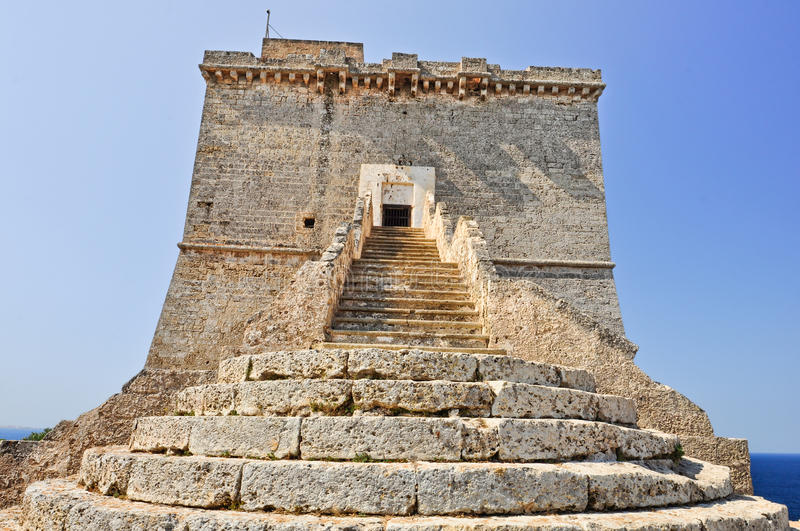 Coastal tower. Medieval coastal tower called Torre dell'Alto, built in 16th century, in natural park of Porto Selvaggio in Salento, Apulia. Italy royalty free stock photography