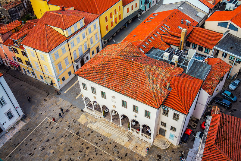 Coastal town Koper in Slovenia. Central square of coastal town Koper in Slovenia seen from above. Historical buildings with red roofs, cafes, shops and royalty free stock photography