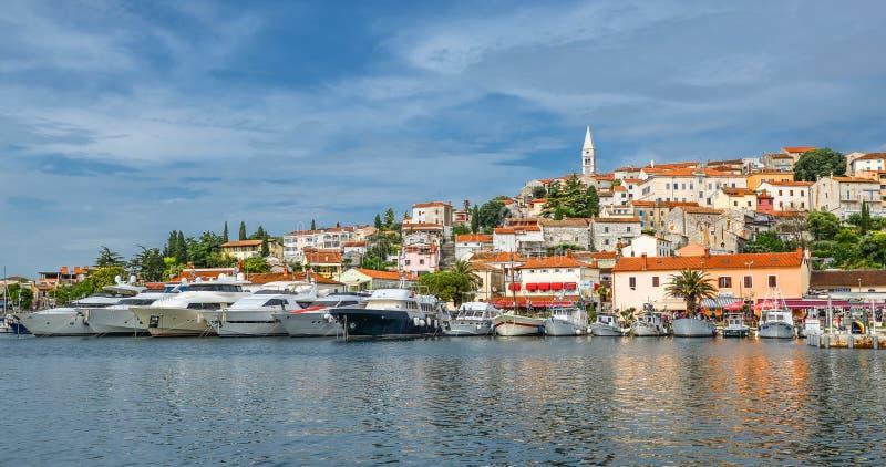Coastal town of Vrsar, Istria, Croatia. Rovinj - beautiful antique city, yachts and Adriatic Sea. royalty free stock photos