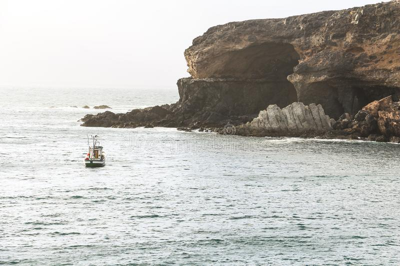 Coastal view with boat in Ajuy, Fuerteventura. Coastal view with boat in Ajuy Fuerteventura royalty free stock images