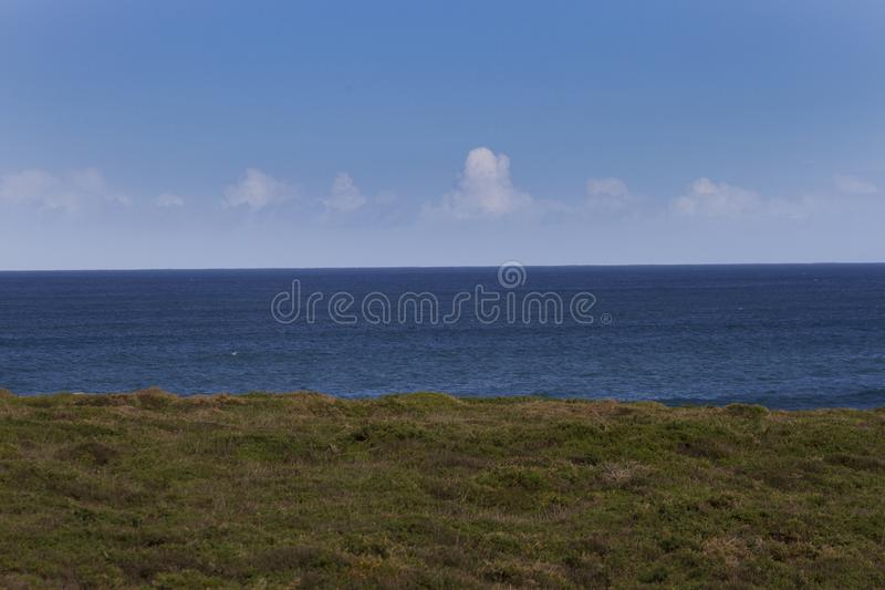 Coastal view. View from grassy coastal bank out to sea royalty free stock image