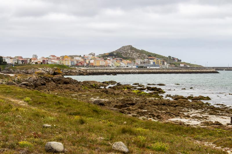 Coastal view of Muxia, Spain. Overcast summer coastal view of Muxia or Mugia on the Way of St. James, Camino de Santiago, Province of A Coruna, Galicia, Spain stock image