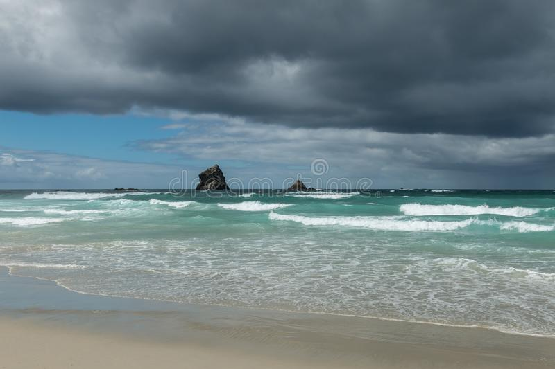 Coastal view of New Zealand with storm brewing in distance. Dunedin, South Island royalty free stock images