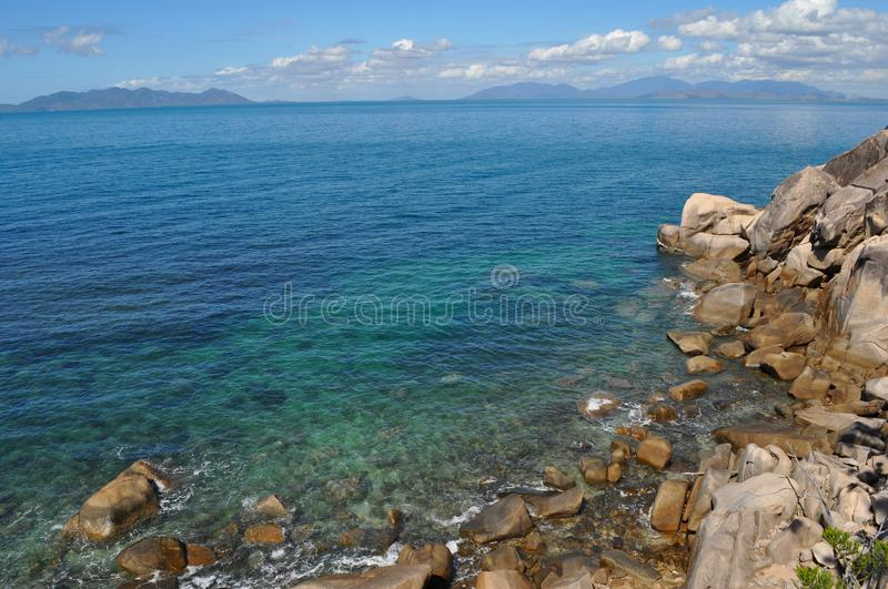Coastal view, from rocky seashore to horizon, Australia. Coastal view through from Gabul Way walk between Nelly Bay and Geoffrey Bay on Magnetic Island, looking royalty free stock photography