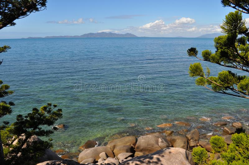 Coastal view, from rocky seashore to horizon, Australia. Coastal view through from Gabul Way walk between Nelly Bay and Geoffrey Bay on Magnetic Island, looking royalty free stock images