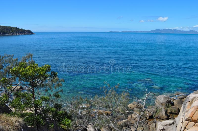 Coastal view, from seashore to horizon, Australia. Coastal view through from Gabul Way walk between Nelly Bay and Geoffrey Bay on Magnetic Island, looking royalty free stock photography