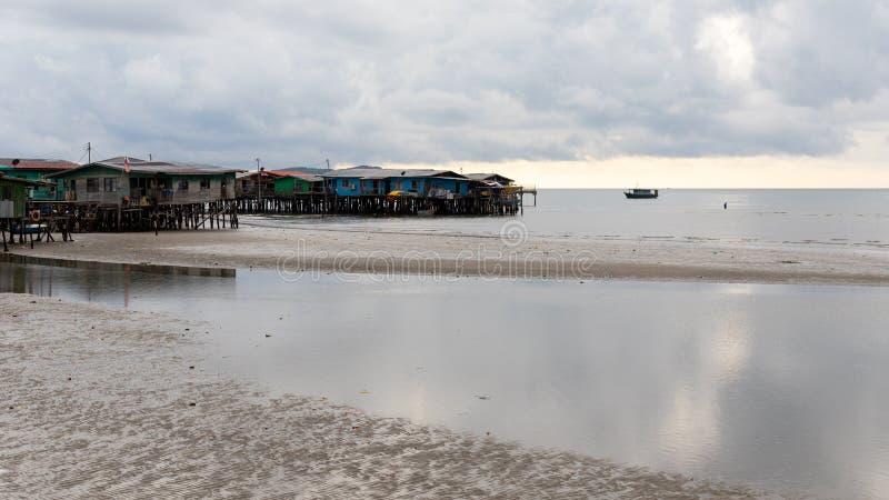 Coastal Village Sea Low Tide Landscape Poverty Dilapidated Homes stock photos