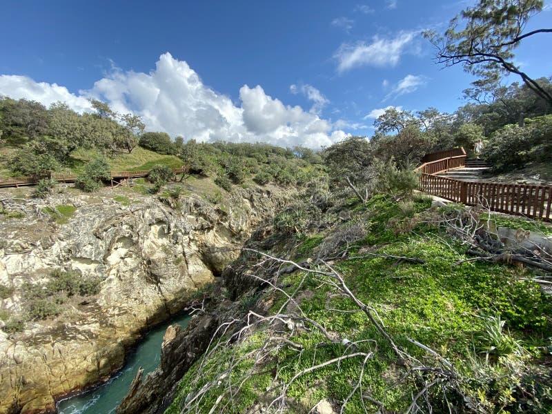 Coastal walk on a tropical island paradise in Queensland, Australia royalty free stock photos