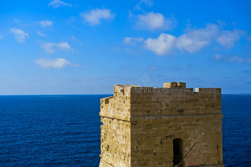 Coastal watch tower at the Mediterranean. The coastal watch tower Torri ta Xutu at Wied iz Zurrieq, Malta stock photography