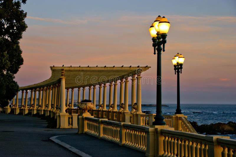 Coastal way sunset with Pergola at Foz do Douro. Oporto, Portugal royalty free stock photography