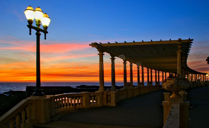Coastal way sunset with Pergola at Foz do Douro. Oporto, Portugal stock photos