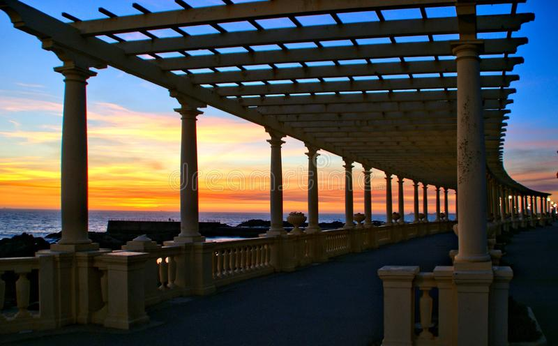 Coastal way sunset with Pergola at Foz do Douro. Oporto, Portugal stock photo