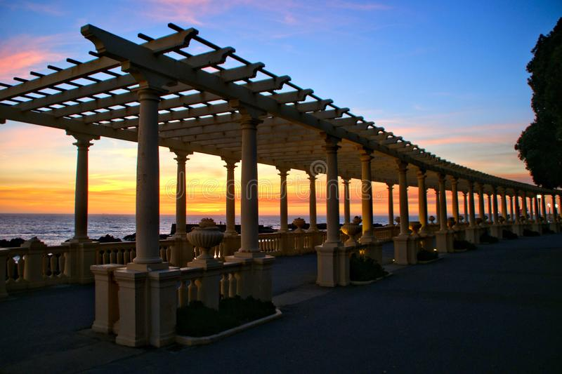 Coastal way sunset with Pergola at Foz do Douro. Oporto, Portugal royalty free stock image